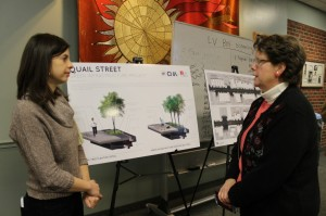Mary Millus (left) explains the Quail St. Green Infrastructure Project/ Ariana Wilson